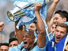 CHAMPIONS: Manchester City captain Vincent Kompany lifts the English Premier League trophy.