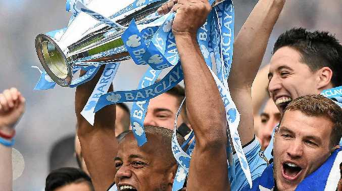 CHAMPIONS: Manchester City captain Vincent Kompany lifts the English Premier League trophy.