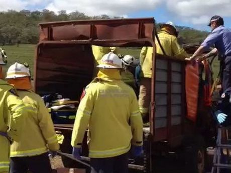 Emergency services work to free Edwin Metzroth from a cattle feeding machine on his Nobby property.