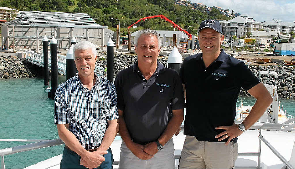 Cruise Whitsundays chief executive officer Nick Hortle reviewed the development with Port of Airlie sales consultant Alan Robinson and sales manager Andrew Forster last week.