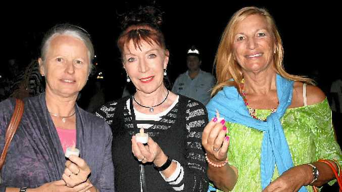 CANDLE LIGHTING: Suzette Pelt, Annie Judd and Catriona Pallett show their support at the Whitsunday Crisis and Counselling candle lighting ceremony last Wednesday.