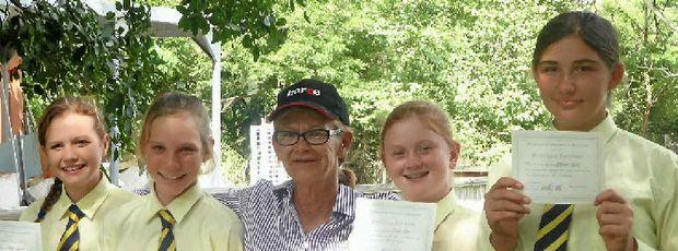 PONY CLUB: Alyssa Turner, Tori Mansfield, Lanie Krog and Breeanna Purvis receive their C Certificate from instructor Sue Greenhalgh.