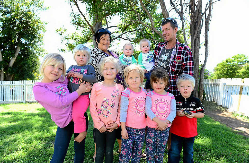 HIT HARD: Rockhampton mother-of-12 Linda Porter and her husband Mark (back row) are worried about what the federal budget will mean for their family, which includes twin sons Huxley and Saxxon (back) and Starlee, Havyn, Hallee, Taytum and Tander (front).