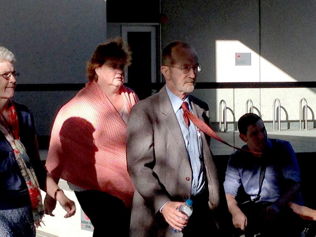 Ian Hunter, senior education officer, leaves the court in Brisbane.
