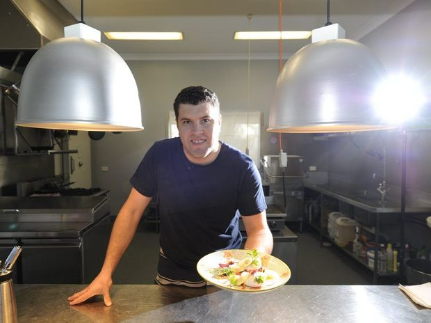 CULINARY ADVENTURE: Chef Nathan Earp at Austin & Co with a dish made from fresh, local produce. Photo JoJo Newby / The Daily Examiner
