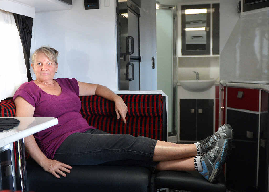 Tullmack Caravans' Heather Adair shows off some of the features in the brand new Traveller Caravans Utopia model at the expo. Photo Pamela Frost / Daily Mercury