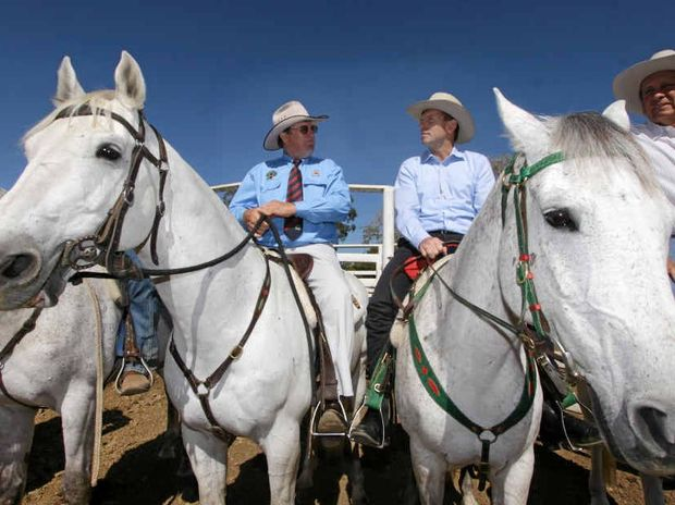 Opposition Leader Tony Abbott on horseback flanked by Cattlemen Graeme Acton and Cameron McIntyre at Acton's property Paradise Lagoons outside Rockhampton.