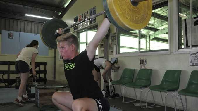 MEDAL GOAL: Weightlifter Shane Wagner trains at the Toowoomba State High School Mt Lofty gym ahead of the Commonwealth Championships at Malaysia.