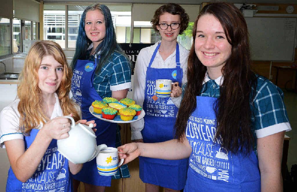 PIECE OF CAKE: Byron Bay students Chloe Creecy, Chiara Hendry-Walpole, Rayne McGaughpan and Mytharia Johnston, prepare for the Biggest Morning Tea.