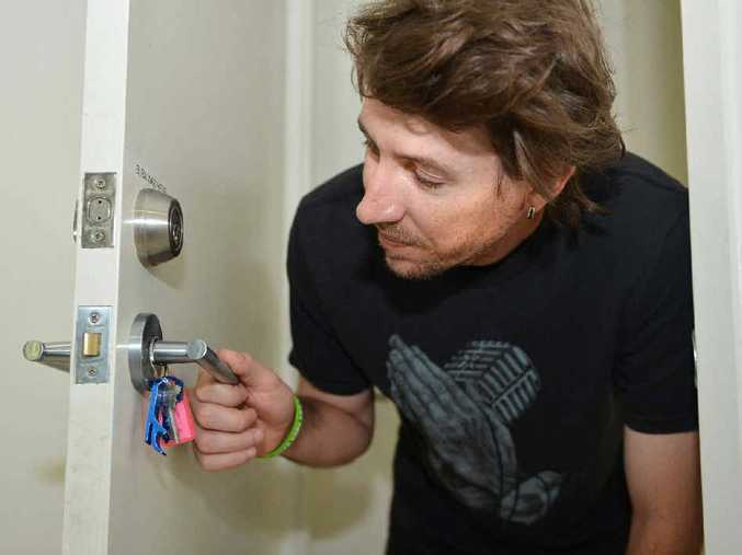 PROBLEMS: Ryan Stockwell-Jones shows some of the shonky jobs done on his door knobs, which don't shut the door properly.