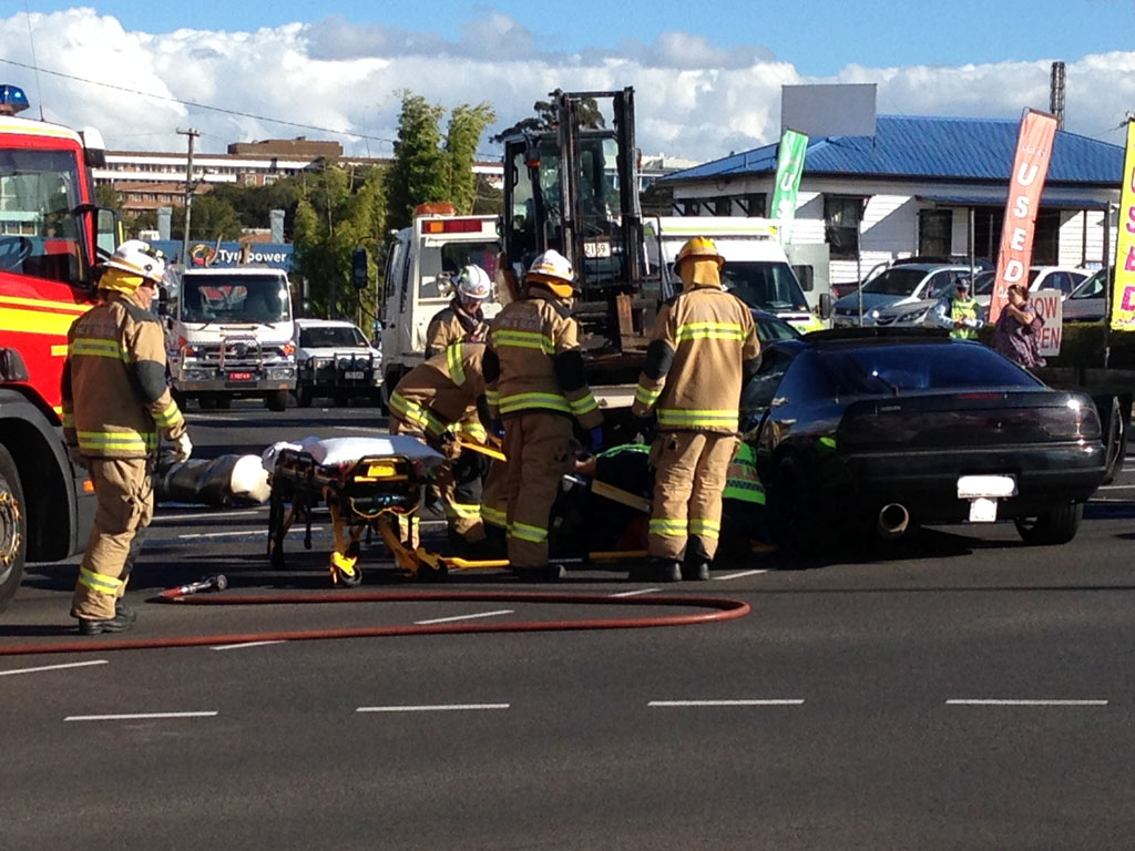 Emergency services at the scene of a three-vehicle crash in the Toowoomba CBD.