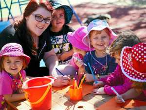 FUN TIMES: Childcare worker Stacey Booth loves her job, seen here with Chloe, Logan, Brooke, Abbie, Isabella and Brooke.