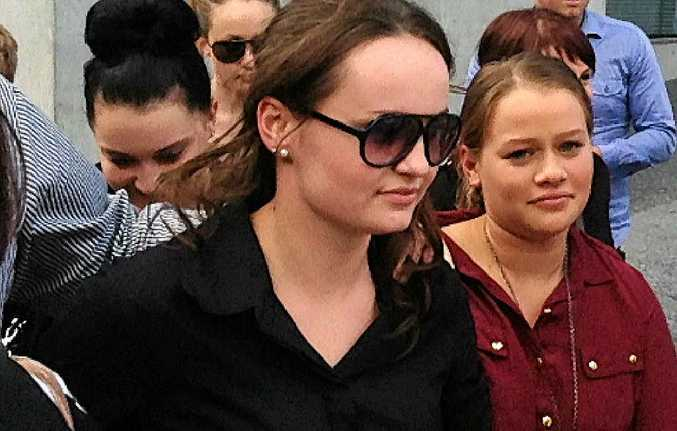 IN COURT: Meghan Hopper (in sunglasses) walks with friends from Brisbane District Court.
