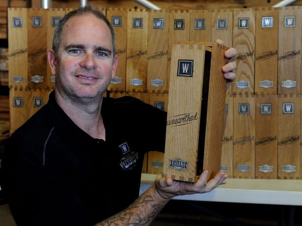 LOCAL RUM: Distiller Rick Prosser with the first of the Waterview Limited 100 silver edition at Schmeiders Cooperage.
