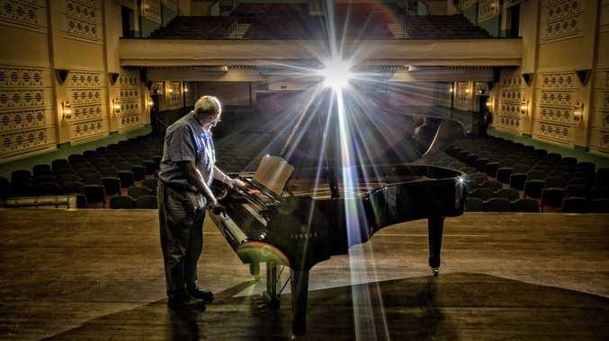 Saraton theatre owner Spiro Notaras gives the newly purchaed Yamaha grand piano a try on stage at the theatre. Photo Adam Hourigan / The Daily Examiner