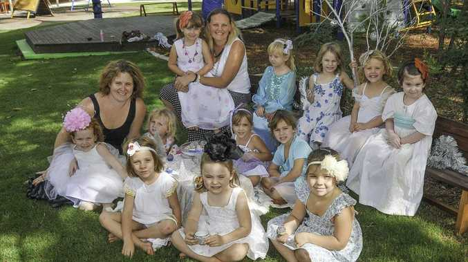 TEA PARTY: Organisers of the Kookaburra Creek Kindergarten annual tea party, Pattie Maughan and Jodie Logan, with the girls from the Green Group.
