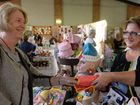BIG BUSINESS: Ann Tenthy collects her purchases from stallholder Karen Shelley.