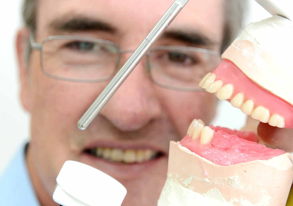 TOP SERVICE: Dental prosthetist David Banfield from Silkstone Dental Clinic with some false teeth.