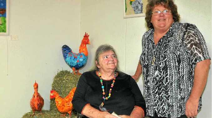 SPECIAL: Valerie Herzog and Sue Daw with some of Sue's papier mâché chooks.