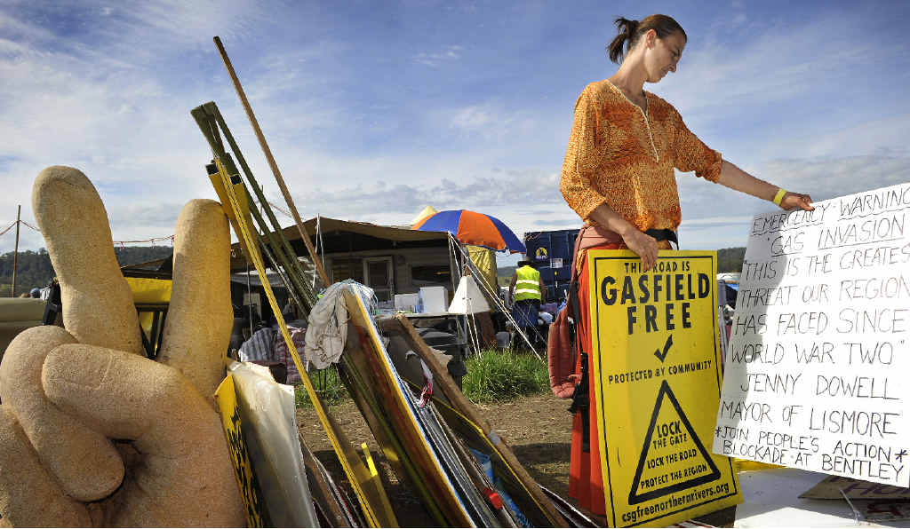 MOVING ON: Terri Nicholson of The Channon sorts the placards and posters while helping to pack up the Bentley protest site after Metgasco's licence was suspended.