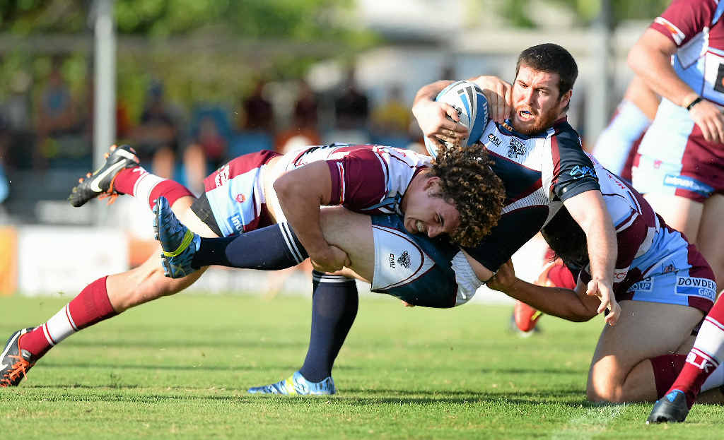 PLAYING ROUGH: Capras player Peter Gallen is tackled in the match against the Mackay Cutters on Anzac Day.