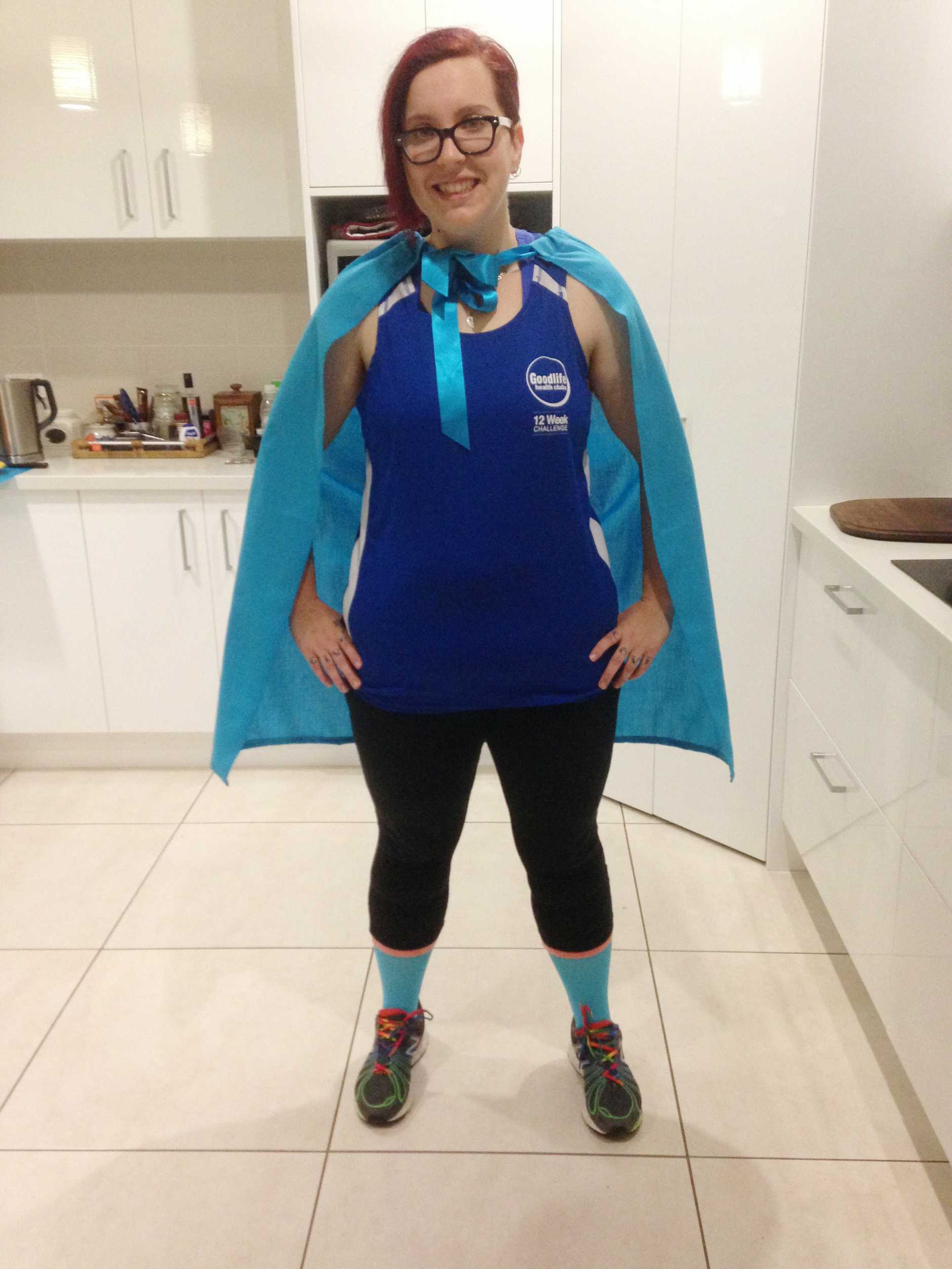 Angela Baker is all smiles after dropping nearly 50kg.