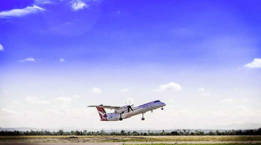 A regional flight lands at Moranbah Airport