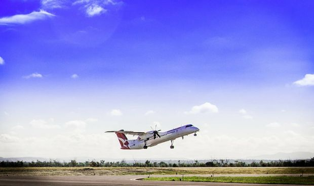 A regional flight lands at Moranbah Airport