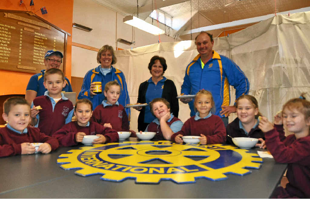EAT UP: Central School students get a good start to the day with the help of Rotary members Yve Stocks, Christine Dolley, Joy Eastwell and president Darren Bray.