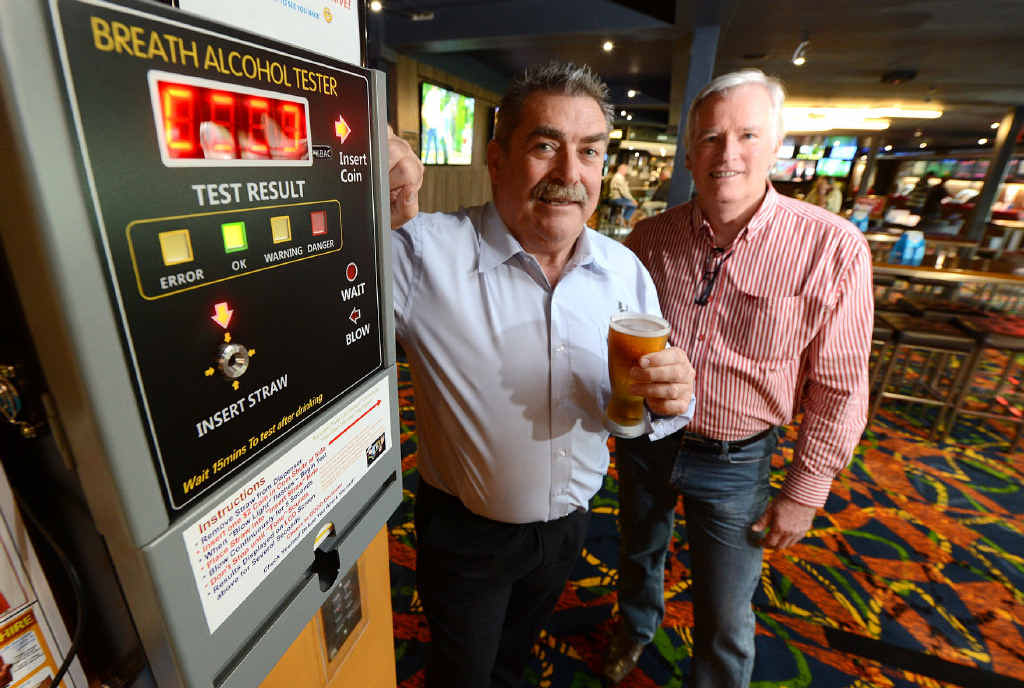 """TESTING TIMES: Brothers Leagues Club general manager Mark Hennelly and BreathPatrol owner Garth McNeil check out the new """"breathalyser""""."""