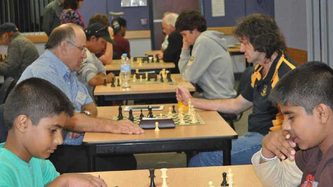 YOUR MOVE: Gladstone junior Thasindu Chandrasekara plays his brother Aishwaryia Chandrasekara in an event last year.