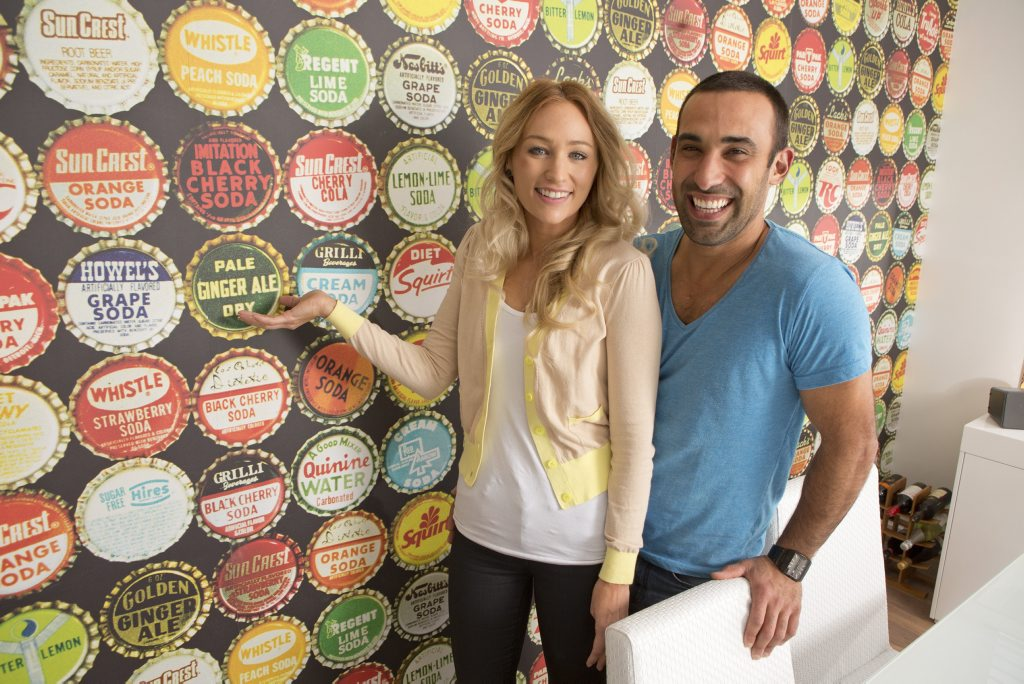*WARNING EMBARGOED CANNOT RUN IN PRINT UNTIL TUESDAY MAY 20, CANNOT RUN ONLINE UNTIL 11PM MAY 19* Melbourne homeowners and House Rules contestants Lisa and Adam with the wallpaper in their renovated home. Supplied by Channel 7.