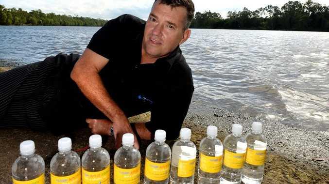 Mark Ricks with bottles of water branded as Random Act of kindness. Photo Allan Reinikka / The Morning Bulletin