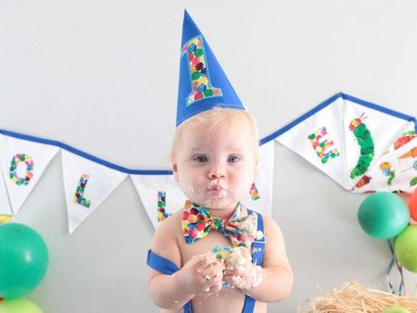 SO YUM: Oliver Mackie celebrated his first birthday with a colourful and messy cake smash on May 16. Photo Debbie Parr