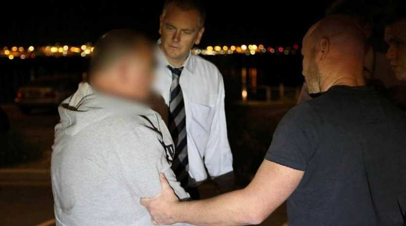 A supplied image dated 25th, May, 2014 shows former Detective Glen McNamara being arrested in the Sydney suburb of Kyeemagh. Mr McNamara has been charged with the murder of Jamie Gao. (AAP IMAGE/NSW POLICE)