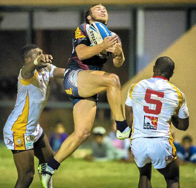 CQ Capras' player Reece Baker claims a high ball against a determined PNG Hunters side during their match at Marley Brown Oval in Gladstone.