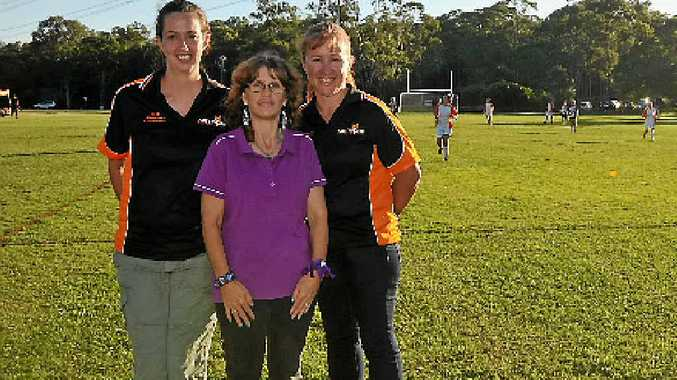 Mel Kent-ford, Karen Lange and Catherine Stewart from the Meteors Soccer Club, which dedicated its senior home games to raising awareness as part of domestic violence protection month.