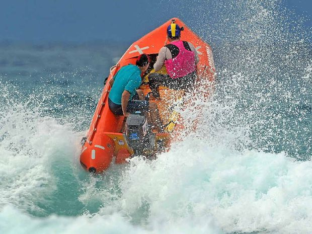 Tannum Sands Masters Inflatable Rescue Crew crew battles the rough conditions at Coolum. Photo Contributed