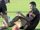 READY TO GO: Justin Hodges receives attention to his ankle during a training session yesterday.