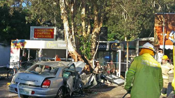 Scene of a crash on Noosa Drive where an elderly lady lost control of her Hyundai sedan, hitting two male backpackers and crashing into a tree.