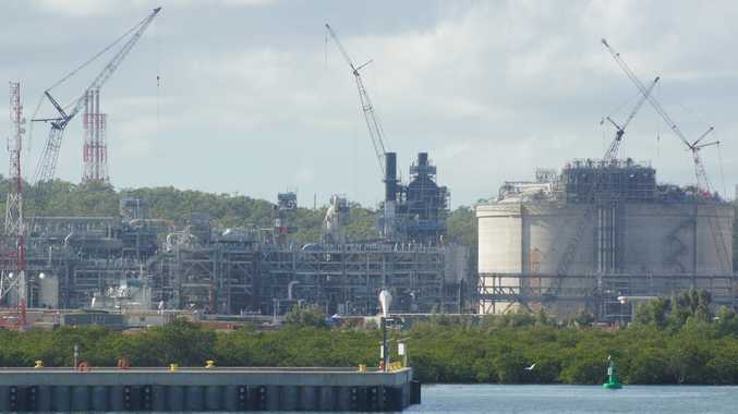 The QCLNG site, including tanks and trains, as seen from the quarterly construction cruise on Gladstone harbour.
