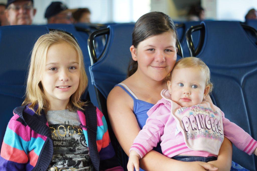 Mikaylah, 10, Shae-Leigh, 12, and Jorgiah, 1, enjoyed the construction cruise on Gladstone harbour.