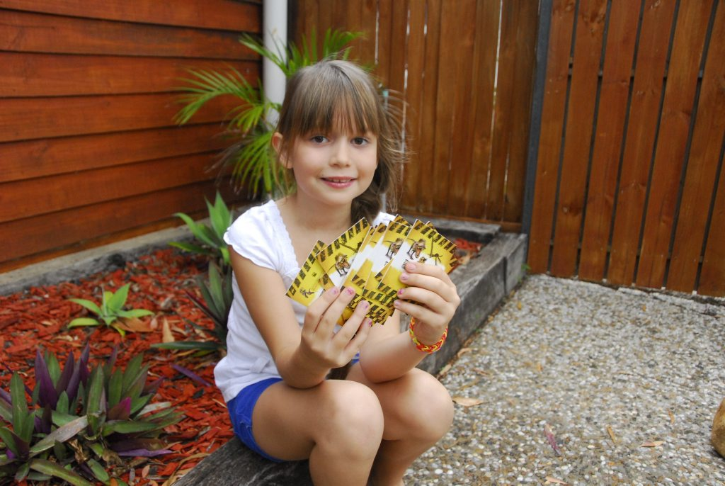 Paige Munn, 7, loves The Observer's Dinosaur Collector Card series.