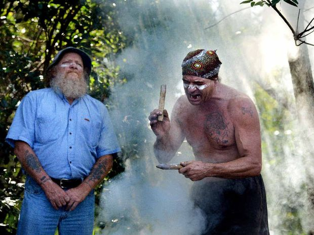 OBJECTION: Michael Ryan, left, and Burrell Jakamarra at a smoking ceremony in North Lismore to mark opposition to the North Lismore plateau development.