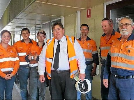 HELPING OUT: Aurizon employees (from left) Ebony Ey, Conor McEvoy, Stevan McDonald, the Salvation Army's Captain Jeff Bush, Rod Lanzon, Gavin Sawtell and Rom Lanzon held a barbecue for the Red Shield Appeal.