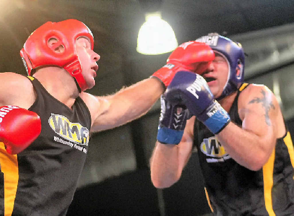 LEFT JAB: Clint Osborne lands a blow on Whitsunday Martial Arts' ally Orren Jameljanenko during their boxing bout.