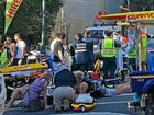 MOWED DOWN: The chaotic scene near Hastings St where a car hit two backpackers before slamming into a tree.