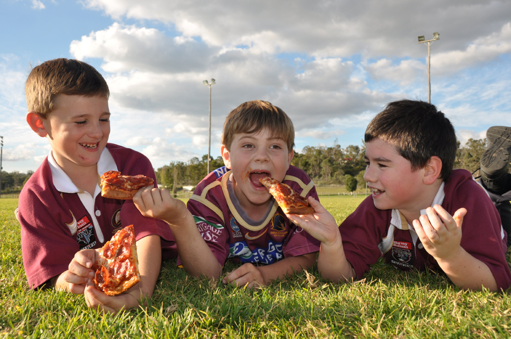 Seven year olds Jesse Scanlan, Toby Usher and Cooper Morton have never seen NSW win a series, and don't expect them to any time soon. Photo: Kirsten Payne