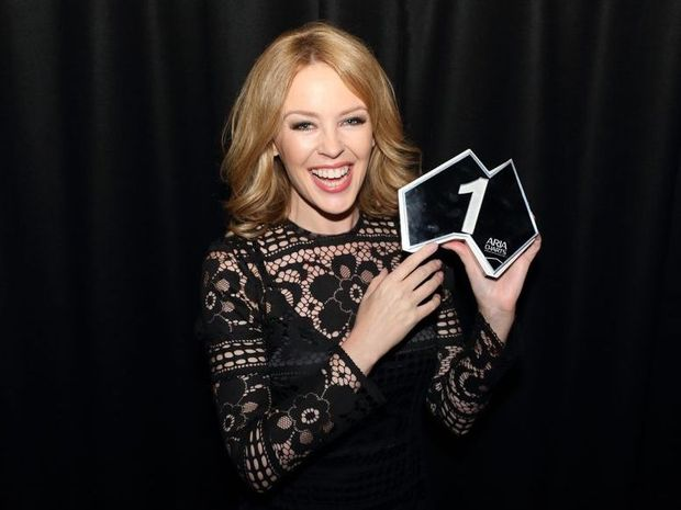 Singer Kylie Minogue with her ARIA No 1 Chart Award.