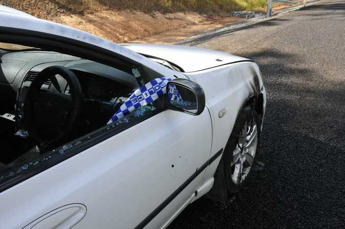 Windows were smashed on a ute that was set alight by the side of the Bruce Hwy near Calliope in the early hours of Wednesday.